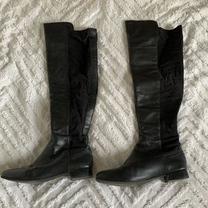 Knee high leather and elastic boots
